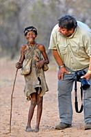 Old San woman (bushmen woman) and photographer, Kalahari, North Namibia, Namibia