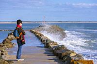 Woman Watching Waves on the Jetty at Jard-sur-Mer Harbor, Sables-d'Olonne District, Vendée Department, Pays de la Loire Region, France, Europe.