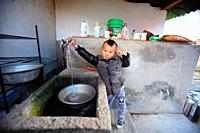 Boy in the kitchen, yunnan province, china