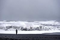 A rough sea in the Reynisfjara black sands beach (region of Sudurland, Iceland).
