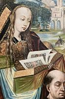Sumptuously dressed medieval lady with long golden tresses, reads the illuminated pages of a golden book above the head of a bald monk in a painting f...