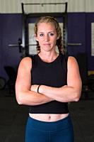 Portrait of a young fit woman during a workout at a crossfit gym focusing on health and fitness for female athletes.