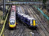 Scotrail passenger train and Virgin Trains train and tracks at Waverley Station in Edinburgh, Scotland, United Kingdom.