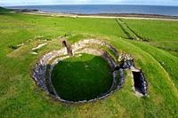 Carn Liath broch 2000 years fortified homestead on North Sea coast near Golspie, Sutherland, Scotland. Looking south east.