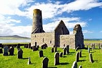 Saint St. Magnus Church, Egilsay, Orkney Islands, Scotland. 12th C Viking Norse round bell-tower tower Christian Saint Magnus's chapel and graveyard.