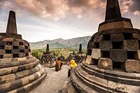 Indonesian tourists in Borobudur Temple, a UNESCO World Heritage Site in Magelang (Magelang Regency, Central Java, Indonesia).