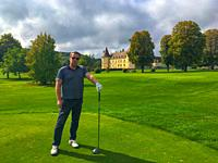 Proud Golfer Holding his Driver in a Sunny Day with a Castle in background in Chailly-Sur-Armancon in France.