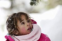 Girl playing with snow. Sierra de Guadarrama, Madrid province, Spain.