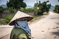 Vietnamese farmer in Dong Tam (Ninh Binh province, Vietnam).