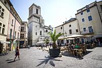 View of square and Notre-Dame-et-Saint-Castor Cathedral of Nîmes (department of Gard, region of Occitanie, France).