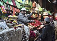 Flower seller at Nizamuddin Dargah, the Sufi saints mausoleum, Old Delhi, India.