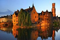 Belgium, Bruges, World Heritage Site, Rozenhoedkaai (Rosary quay) and belfry by nignt.