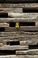 Wall decorated with railway sleepers. La Casa Negra (The Black House). Almansa. Albacete province. Spain.