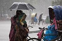DHAKA, BANGLADESH - MAY 04 : People on street during sudden rain in Dhaka, Bangladesh on May 04, 2018.