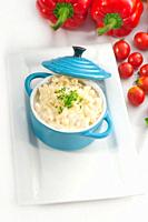 macaroni and cheese, kids favourite dish, on a blue little childish clay pot with vegetables on background