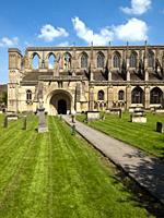 Picturesque Malmesbury Abbey in spring sunshine, Wiltshire, UK.