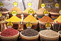 Stocked baskets of savory spices on display for sale at Istanbul Spice bazaar in Turkey.