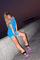 Beautiful woman posing for the camera in different sensual positions in beautiful sunset in Yalta, Crimea.