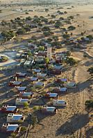 The Sossusvlei Lodge in Sesriem at the edge of the Namib Desert. Aerial view. Namib-Naukluft National Park, Namibia.