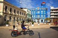 Bici Taxi in front of the Santa Cecilia Convention Center-Centro de Convenciones at the historic center, Camagüey, Cuba, West Indies, Central America.
