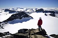 Norway, Oppland, Vaga, Jotunheimen National Park, trekker at the summit of Galdhopiggen, the tallest mountain in Norway and Scandinavia at 2469m, Mode...