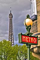 On background Eiffel Tower, Tour Eiffel, Subway station entrance lamp, metro station sign, Metropolitain, Paris, France, Europe.
