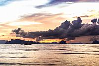 Dramatic sunset at Ao Nang Beach, Krabi, Thailand.