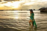 Young girl posses at Ao Nang Beach, Krabi, Thailand.