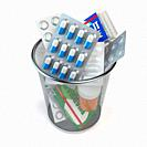 Pills, capsules and medicines thrown in the dustbin isolated on white. End of treatment or healthy lifestyle concept. 3d illustration.
