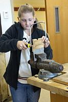 8th Grade Girl Using Coping Saw in Technology Class, Wellsville, New York, USA.