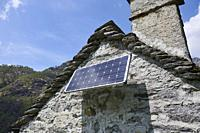 A solar panel installed on a rustic building. Maggia. Vallemaggia District. Ticino. Switzerland.