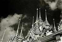 Spires of the Buddhist temple Loha Prasat Metal Castle of Wat Ratchanadda in Bangkok in Thailand in Southeast Asia Far East.