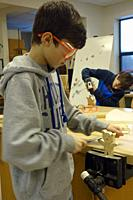 8th Grade Boys Using Tools in Technology Class, Wellsville, New York, USA.