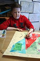 6th Grade Boy Painting in Art Class, Wellsville, New York, USA.