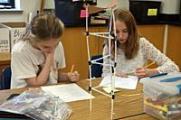 6th Grade Girls Building Model of Earthquake Resistant Structure, Wellsville, New York, USA.
