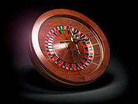 Casino roulette wheel on black background. 3d illustration.