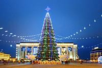 Christmas tree, illuminations and decorations in front of building of the Palace of Republic in Oktyabrskaya Square - famous place in central Minsk, B...