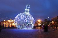 City Christmas illuminations like a large ball Christmas decorations in town Oktyabrskaya Square in central Minsk, Belarus.