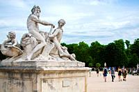 La Seine et la Marne statue group by Nicolas Coustou, in a sunny day. Jardin des Tuileries, Paris, France.