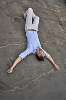 business man lying on street, exhausted, blogger Axel Sprenger, in Munich, Germany.