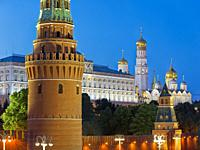 Towers of Moscow Kremlin illuminated at dusk. Moscow, Russia.
