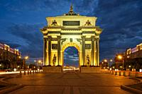 Triumphal Arch, built to commemorate Russia's victory over Napoleon, illuminated at dusk. Kutuzovsky Avenue, Moscow, Russia.