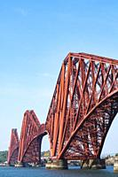 View of the historic Forth Bridge (Forth Railway Bridge) crossing the Firth of Forth between North and South Queensferry, UK.