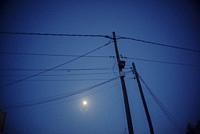 Electricity Pylon and power lines at dusk. Mahon, Menorca, Baleares Spain.
