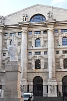 Milan, Italy: L.O.V.E. (´The Finger´) sculpture by Maurizio Cattelan, facing Palazzo Mezzanotte (Stock Exchange Building) in Piazza degli Affari
