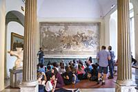 School group listening to teacher in front of the mosaic Battle between Alexander and Darius, from Pompeii, house of Faun, National Archaeological Mus...