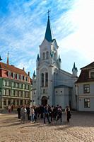 Tourist group near Our Lady of Sorrows Church, Riga, Latvia.