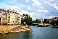 View of the Seine river and Pont de la Tournelle bridge in a sunny day. Paris, France.