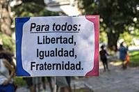Madrid, Spain, 7 th July 2018. Gay pride parade with participants and a placard in Paseo del Prado, 7 th July 2018, Madrid.