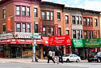 Colored row house and Deli restaurants in Bedfordpark neighbourhood. Northwest Bronx, New York, U.S.A.